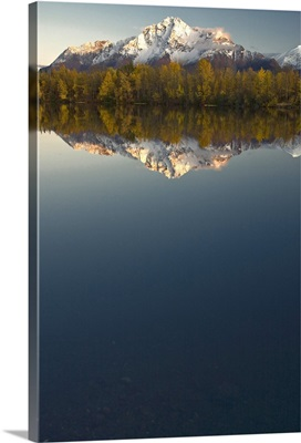 Scenic view of Pioneer Peak reflecting in Echo Lake at sunset Southcentral Alaska