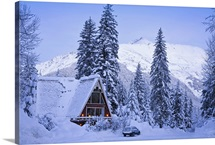 Scenic winter view of an A frame home with the Chugach Mountains in the background