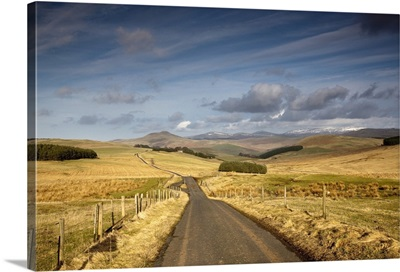 Scottish Borders, Scotland; A Road With Fields On Both Sides