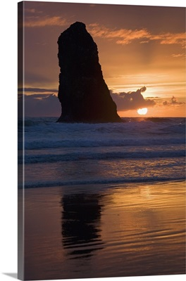 Silhouette Of A Rock Formation At Sunset; Cannon Beach, Oregon, USA