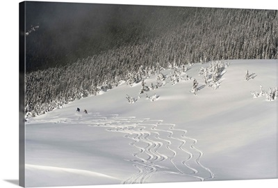 Skiers At The Base Of A Mountain; Whistler, British Columbia, Canada