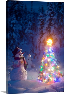 Snowman stands in a snowcovered spruce forest next to a decorated Christmas tree