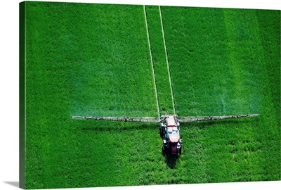 Spray application in green field on the Eastern shore of Maryland, Wye Mills
