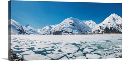 Spring ice breaking apart on the surface of Portage Lake, Chugach mountains, Alaska