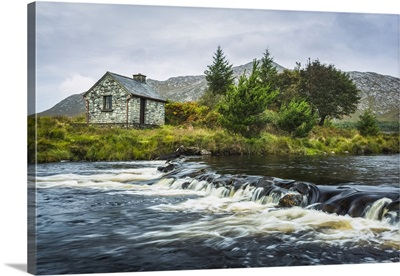 Stone Fisherman's Hut On The Banks Of A Small River, Connemara, County Galway, Ireland