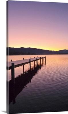 Sunrise over a dock in Lake Whatcom during Winter Bellingham Washington