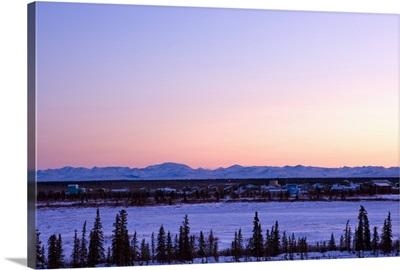 Sunset over a barren landscape near the Village of Noatak with the Baird Mountains