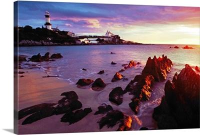 Sunset Over Beach With Lighthouse