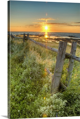 Sunset Over Water With Fence Along The Shoreline; La Martre, Quebec, Canada