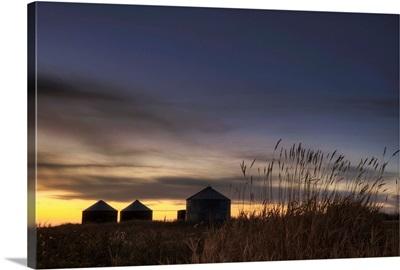 Sunset Silhouetting Grain Silos In Autumn, Rural Alberta, Canada