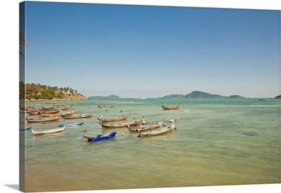 Thailand, Phuket, Rawaii Beach, Longtail Boats Along The Shoreline, Land In Distance