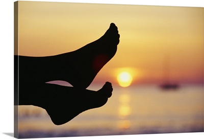 Thailand, Phuket, Silhouette Of Feet In Front Of A Sunset Over The Ocean