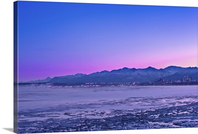 The Anchorage Skyline before dawn with fog rising from the waters of Knik Arm
