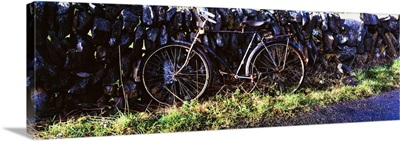 The Burren, County Clare, Ireland, Bicycle Leaning Against Stone Wall