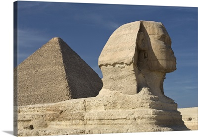 The Sphinx With The Pyramid In Background