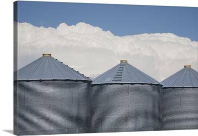 Three Grain Bins With Dramatic Thunder Storm Clouds; Alberta, Canada