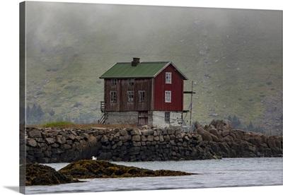 Traditional Fishing Village House Next To Shoreline, Lofoten, Arctic Circle, Norway