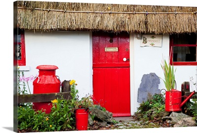 Traditional Irish Cottage With A Red Door And Red Decorative Items, Currabinny, Ireland