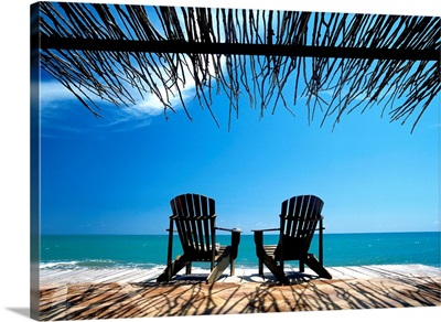 Two Chairs On Deck By Ocean Shaded By Grass Roof; Jamaica