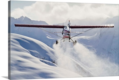 View of a Super Cub air taxi at Tanaina Glacier in the Neacola Mountains, Alaska