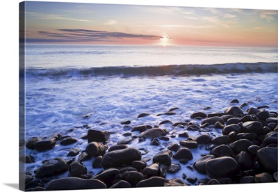 Waves Breaking On Rocky Shore At Dawn, Near Dunstanburgh Castle, Northumberland, England