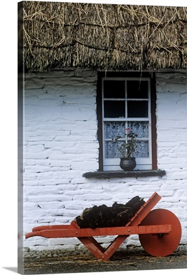 Wheelbarrow In Front Of A Window Of A Cottage, County Clare, Republic Of Ireland