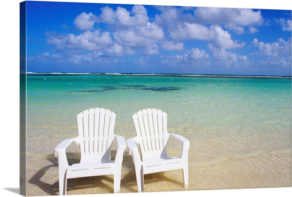 White Beach Chairs On Beautiful Beach, Clear Turquoise Water