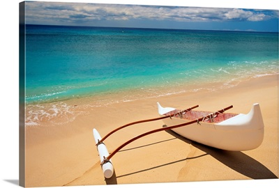 White Outrigger Canoe On Shoreline With Shadow, Calm Turquoise Water