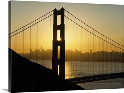 Yellow Sunrise Behind The Golden Gate Bridge With Skyline; San Francisco, California
