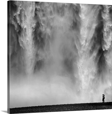 Black and White Photo of waterfall with person