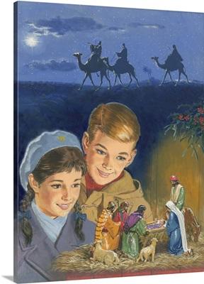 Children admiring Nativity scene