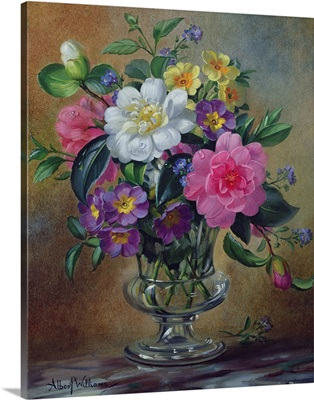 Forget-me-nots and primulas in glass vase