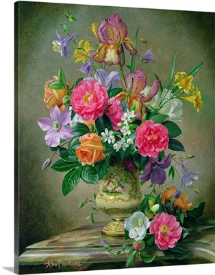 Peonies and irises in a ceramic vase