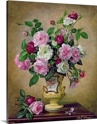 Roses and dahlias in a ceramic vase