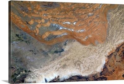 Alien red sand crawls over a bereft African plain