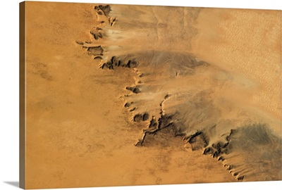 Arid fingers of sand-blasted rock in the hot Saharan wind