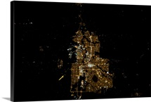 Calgary at night, shining in the foothills of the Rockies.