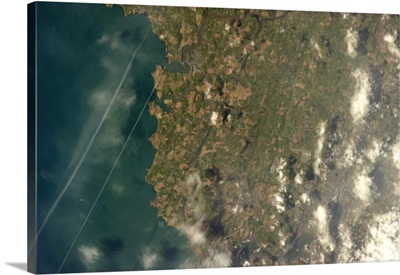 Cork, Ireland, just visible at the edge of cloud on the coast