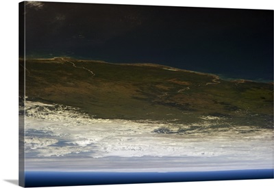Looking across Madagascar to Cyclone Felleng on the horizon