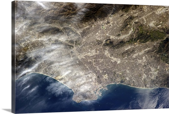 Los Angeles, CA. The grey of pavement and dense population is visible from Earth orbit