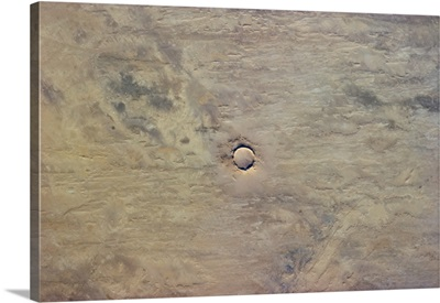 My guess is that this perfect African circle is a meteor impact crater