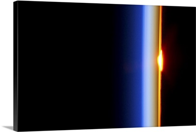 Our atmosphere acts as a lens, distorting the sun as it crosses the horizon