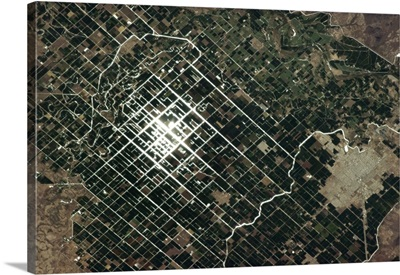 Sunglint catches the irrigation canals of these Mexican farmers