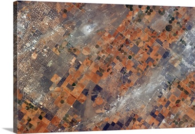 Texas land use patterns - snakes and ladders speckled with oil drilling plots