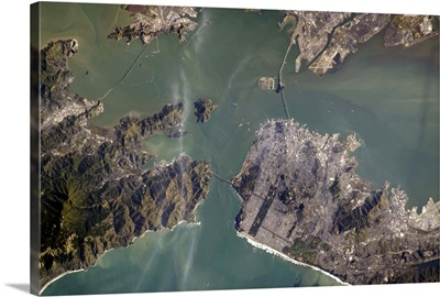 The Golden Gate Bridge from space, and if you look closely, its shadow