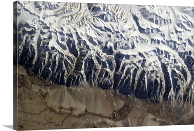 The Himalayas, pushed up by India crashing into Asia, younger than the dinosaurs