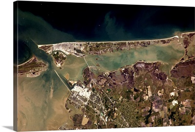 The long beach and silty waters of Galveston, Texas