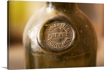 Antique dusty wine bottle with a moulded seal, Chateau Belingard, Dordogne, France
