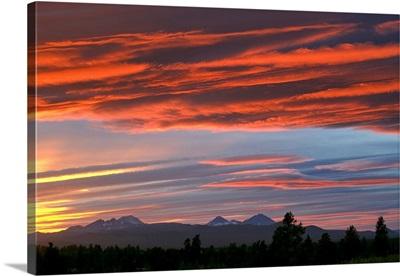 Brilliant colors compete with subtle ones over the Cascades Range of central Oregon