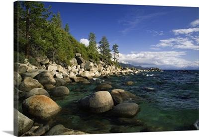 California, Lake Tahoe, smooth granite boulders line the lake shore in clear water